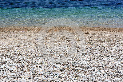 Shoreline with pebble beach and clear water