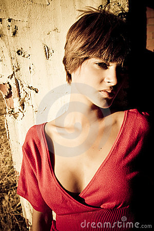 Short haired woman staring at camera