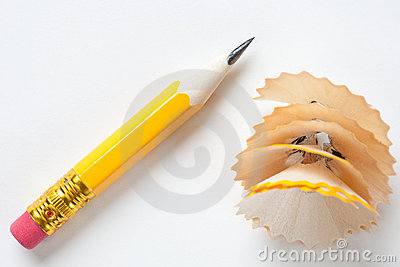 Short yellow pencil on textured white paper