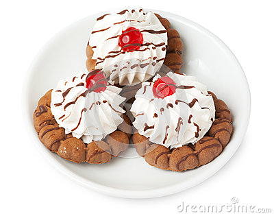 Shortbread cookies with cream  and cherry on plate