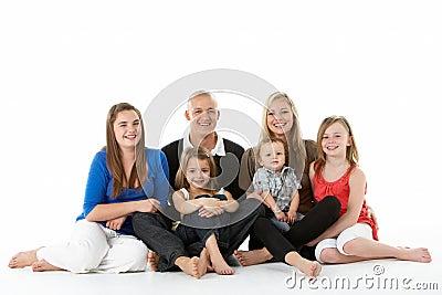 Shot Of Family Group Sitting In Studio