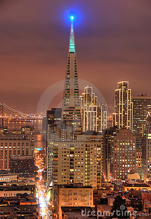 A shot of the Financial district in San Francisco. The buildings are lit up for Christmas. Bay Bridg