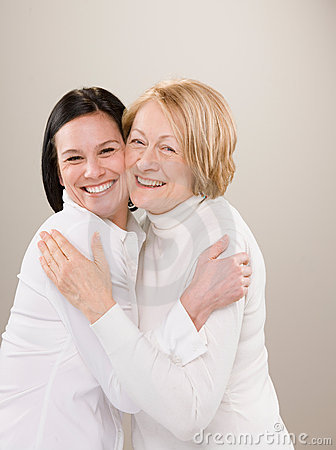 Shot of loving adult mother and daughter hugging