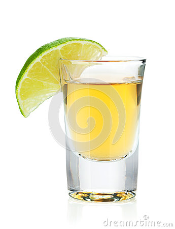 Free Shot Of Gold Tequila With Lime Slice Stock Photo - 28066760