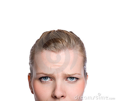 Shot of the upper part of an angry womans face
