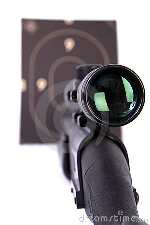 Shotgun with a rifle scope pointing a target