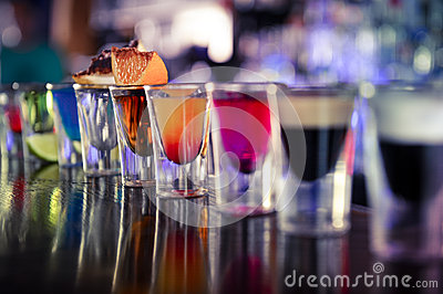 Shots with liquor and alcohol in cocktail bar Stock Photo