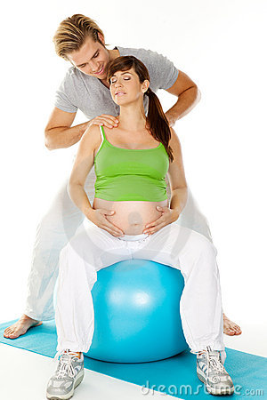 Shoulder massage pregnant woman