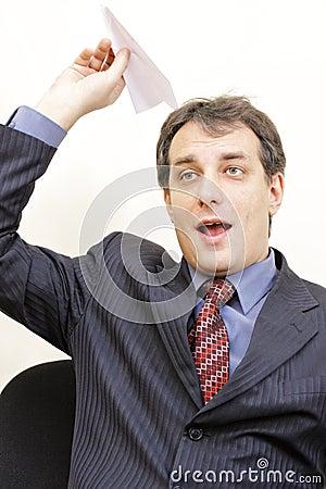 Shouting businessman throwing plane