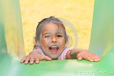 Shouting girl on a slide