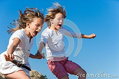 Shouting kids having fun jumping.