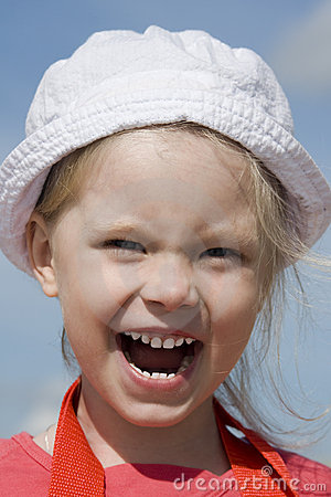 Shouting little girl on the sea coast