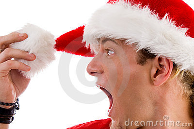 Shouting male looking at his christmas hat