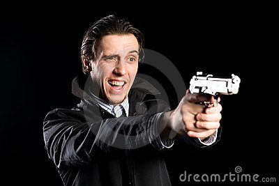 Shouting man firing a pistol