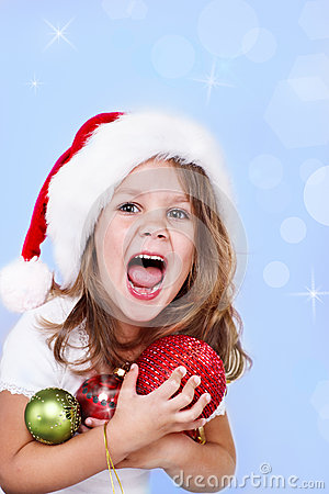 Shouting preschool girl in Santa hat