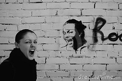 Shouting woman on a brick wall