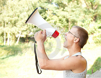 Shouting young man with megaphone