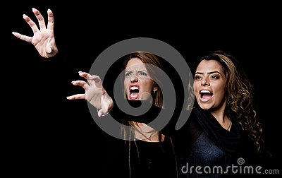 Shouting young women showing hand gesture