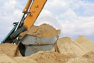 Shovel bucket full of sand