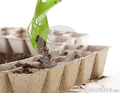 Shovel Placing Soil into Eco-friendly Compost Pots