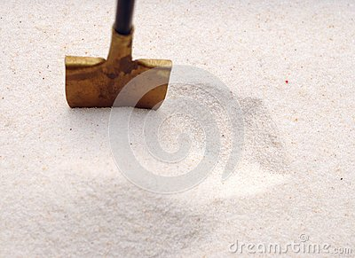 Shovel in a sand