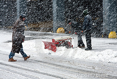 Shoveling snow in blizzard Editorial Stock Image
