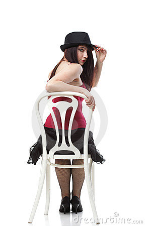 Showgirl woman dance in red corset chair isolated