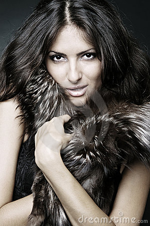 Showy brunette in furs
