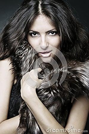 Showy brunette in furs