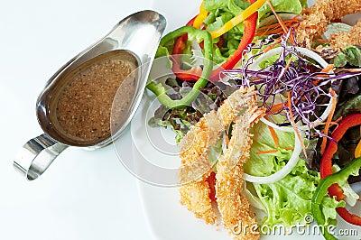 Delicious Shrimp salad serve with brown creamy sauce.