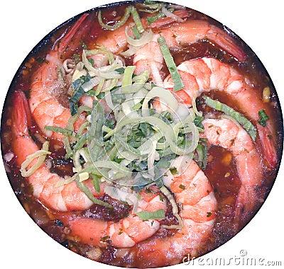 Shrimps on a frying pan about a leek