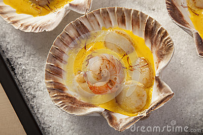 ... scallops in saffron sauce baked in empty shells on a bed of sea salt
