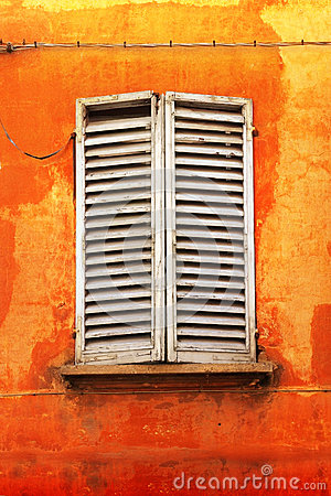 Shutters on orange wall