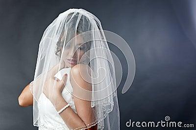 Shy bride with veil