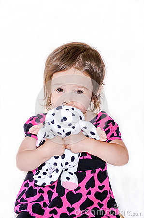 Shy girl and stuffed toy