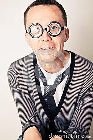 Shy nerd in funny glasses