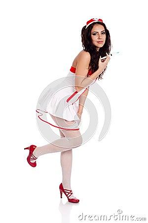Shy sexy nurse holding a leg up
