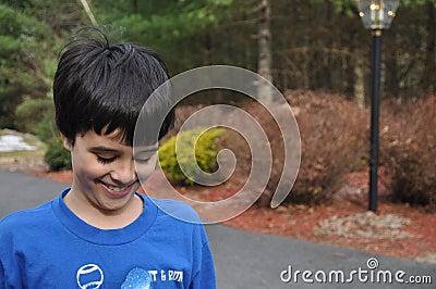 Shy smiling boy