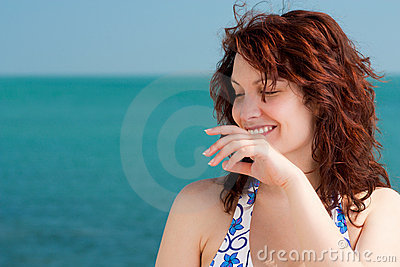 Shy Smiling Woman on a Beach