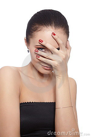 Shy woman covering her face with her hand