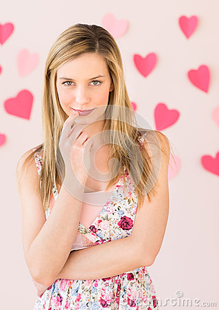 Free Shy Woman With Heart Shaped Papers Against Colored Background Royalty Free Stock Image - 32145866