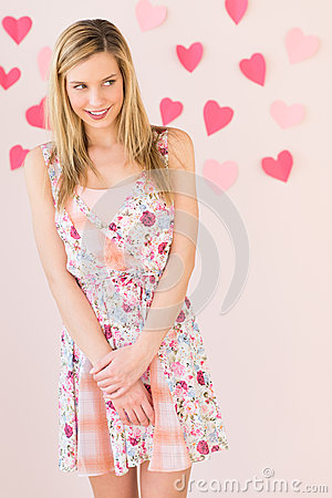 Free Shy Woman With Heart Shaped Papers Stuck Against Colored Backgro Royalty Free Stock Photo - 32145875