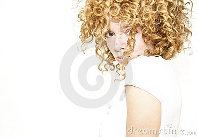 Shy young woman with curly hair