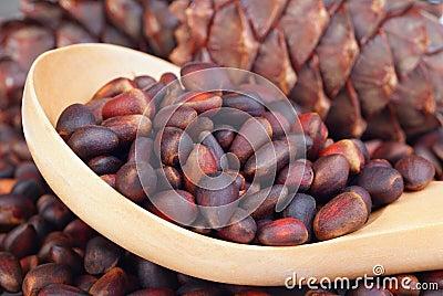 Siberian pine nuts in wooden spoon
