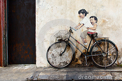 Sibling cyclist Street Art at George Town Editorial Stock Image