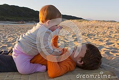 Siblings on the beach