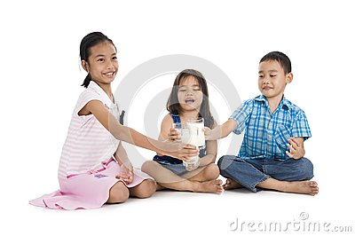 Siblings cheering with milk