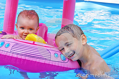Siblings Enjoying the Pool