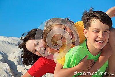 Siblings playing on beach