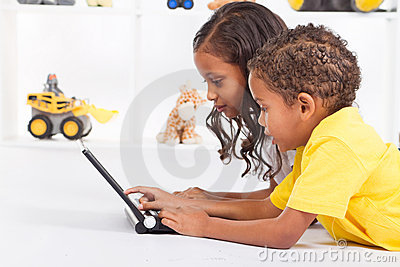 Siblings playing computer